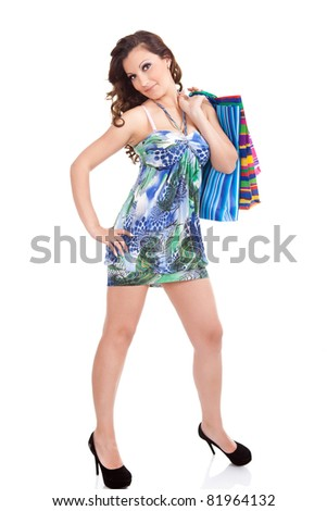 sexy young girl with shopping bags,  isolated on white background - stock photo