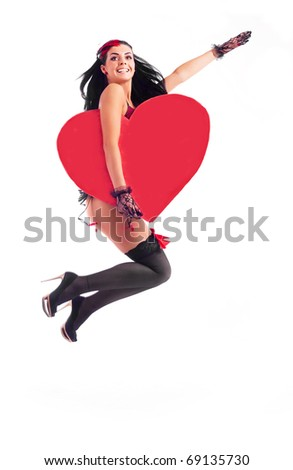sexy young jumping woman with a big heart in her hands