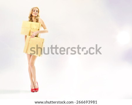 Sexy young lady holding presents - stock photo