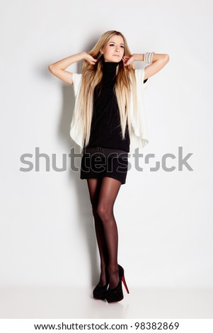 Sexy young lady with blond hair in studio - stock photo