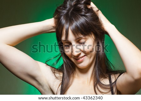 Sexy young lady with long dark hair - stock photo