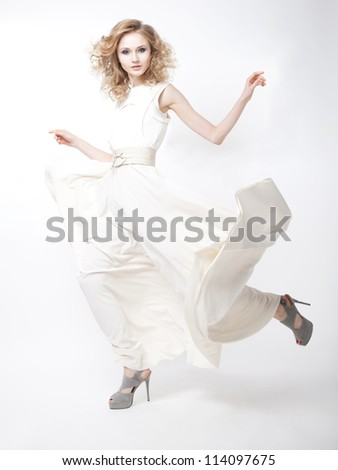 Sexy young lovely female blond hair with flying vernal dress isolated over white background - stock photo
