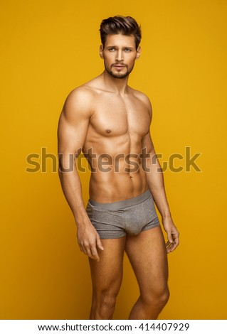 Sexy young male model - stock photo