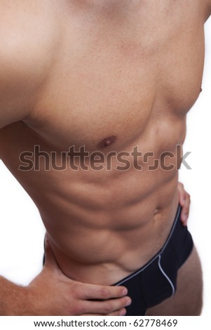 Sexy young male's body, isolated on white