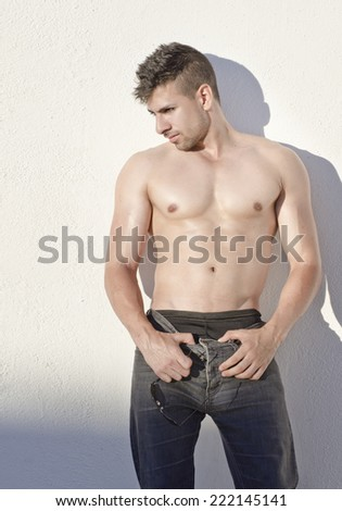 Sexy young man posing at outdoors with sunset light