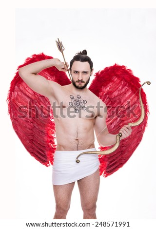 Sexy young man with big red wings. Cupid, Valentine, Archangel, Angel. Studio portrait isolated over white background   - stock photo