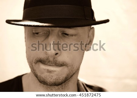 Sexy young man with hat  / Handsome male  - stock photo