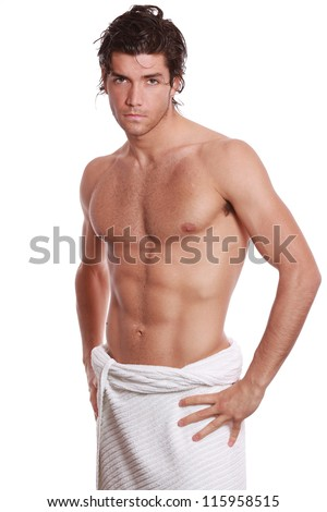 Sexy young muscular man with naked chest and white towel . Isolated on white