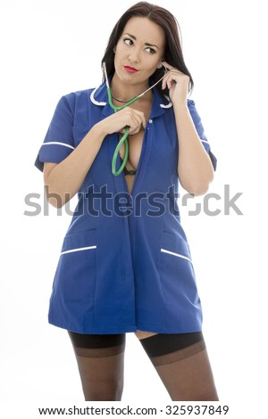 Sexy Young Pin Up Model Wearing A Nurses Uniform and Black Stockings In Pin Up Glamour Poses Against a White Background Isolated Against A White Backgorund  - stock photo