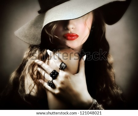Sexy young pretty woman / model with red lips, vintage / retro hat and jewelry is sending a kiss / smooch - closeup - stock photo
