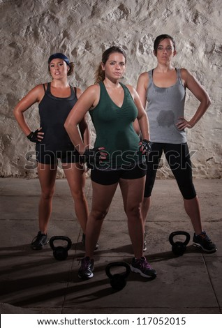 Sexy young white women resting after boot camp workout - stock photo
