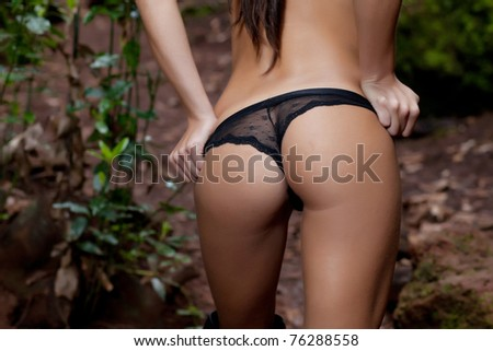 sexy young woman back with black lingerie - stock photo