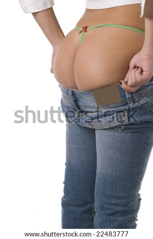 Sexy young woman bottom trying on a pair of blue jeans - stock photo