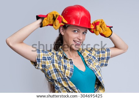 Sexy young woman construction worker. Studio shot - stock photo