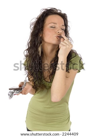 sexy young woman eating chocolate with great pleasure - stock photo