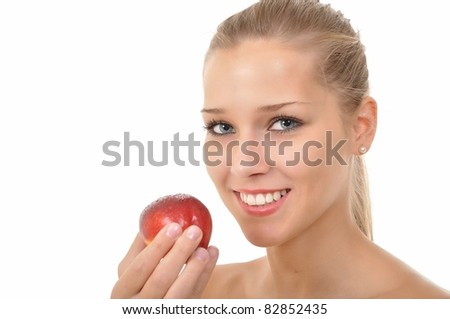 Sexy young woman holding a red nectarine - stock photo
