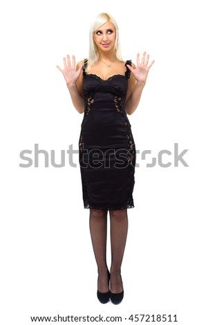 Sexy young woman in a black dress, isolated on white background in full length.
