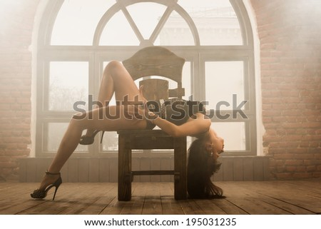 """Sexy young woman in a dancing suit """"GO-GO"""" - stock photo"""