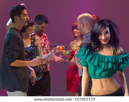sexy, young woman in a night club, smiling - stock photo