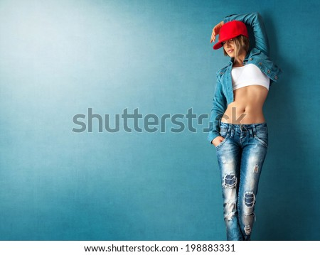 Sexy young woman in a trendy clothes on a grunge background - stock photo