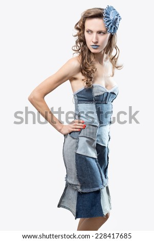 Sexy young woman in a trendy clothes on white. Recycle fashion - stock