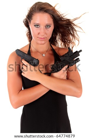 Sexy young woman in black dress holding a handgun and an automatic gun. Studio shot. White background - stock photo