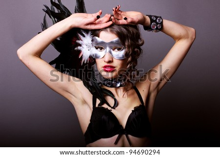 Sexy young woman in lingerie with mask - stock photo