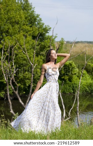 Sexy young woman in white long dress  - stock photo