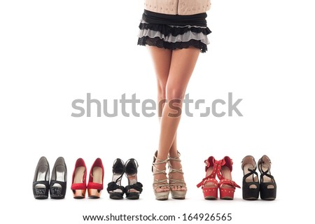 Sexy young woman legs with different kind of shoes on white background.  - stock photo