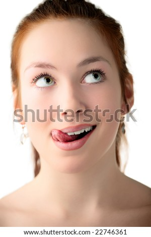 sexy  young woman lick one's lips on white background - stock photo