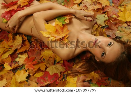 sexy young woman on bright leaves - stock photo