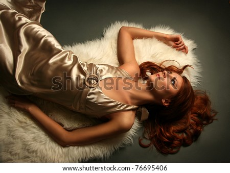 sexy young woman on dark background - stock photo
