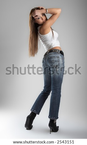 Sexy young woman over grey background - Fashion session