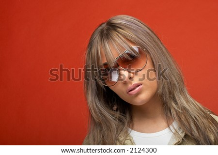 Sexy young woman over orange background with a sexy look