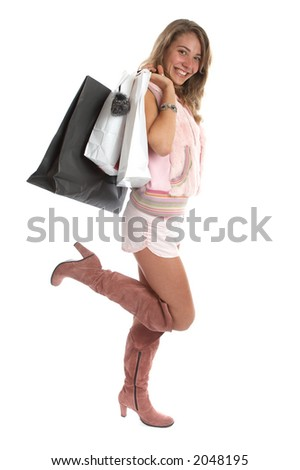 Sexy young woman over white background with shopping bags