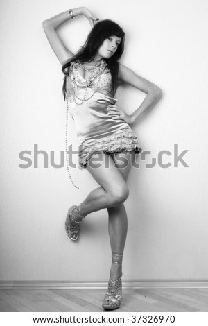 Sexy young woman posing. Black and white photo.