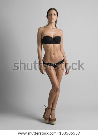 sexy young woman posing for a model agency in lingerie - stock photo