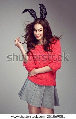 Sexy young woman posing in bunny ears - stock photo