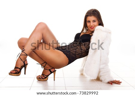 Sexy young woman posing in lingerie and fur coat - stock photo