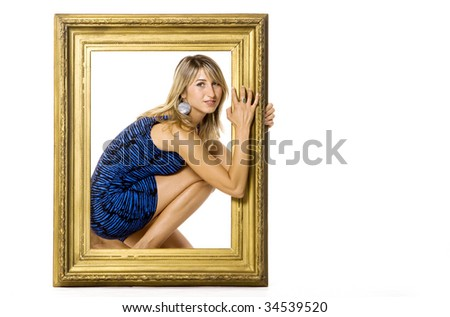 Sexy young woman posing with wooden frame