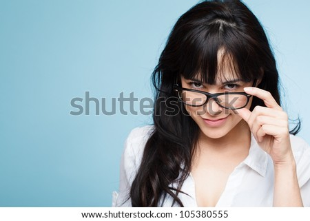 sexy young woman retro girl secretary wearing glasses portrait of blue background - stock photo