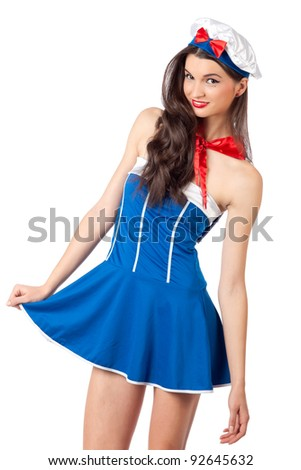 Sexy young woman wearing sailor costume and smiling. High resolution image taken in studio. Isolated on white with copy-space for your ad. - stock photo