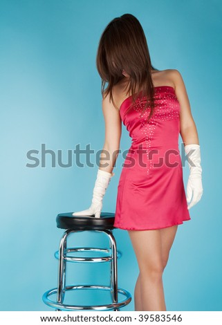 Sexy young woman with a bar chair - stock photo