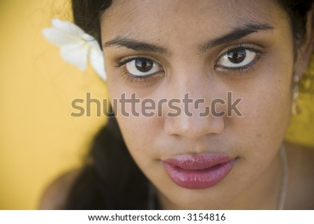 Sexy young woman with a flower in her hair - stock photo