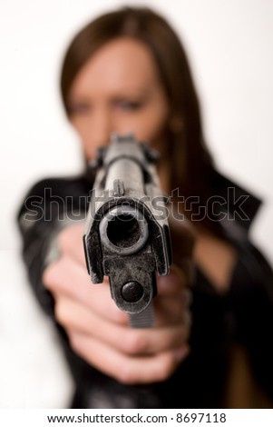 Sexy young woman with a gun isolated on white - stock photo