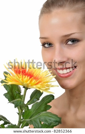 Sexy young woman with blue eyes holding a flower - stock photo