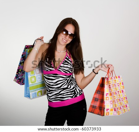 Sexy young woman with colorful shopping bags - stock photo