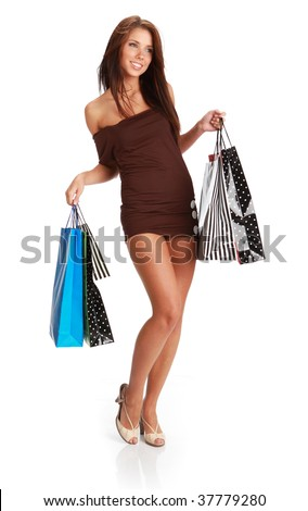 Sexy young woman with colorful shopping bags. consumerism concept