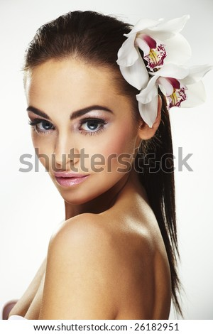 Sexy young woman with flowers - Beautiful portrait of a  sexy woman with bright white flowers. - stock photo