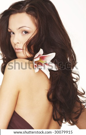 Sexy young woman with flowers - Beautiful portrait of a woman with bright white flowers. - stock photo